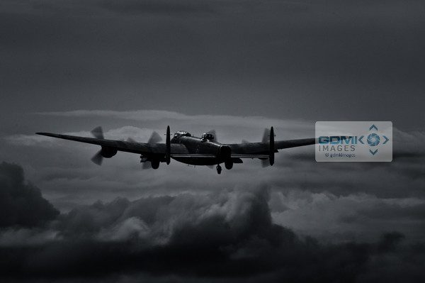 A Lancaster Bomber takes off into a moonlit sky