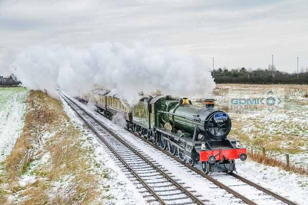 Hall class 4-6-0 Witherslack Hall steam train heading through the snowy Leicestershire countryside on the Great Central Railway