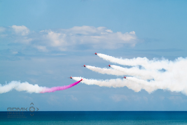RAF Red Arrows aerobatic display team flying over the sea
