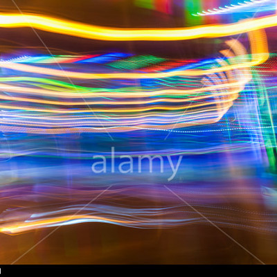 Abstract multicoloured light trails created by movement combined with a long exposure at night