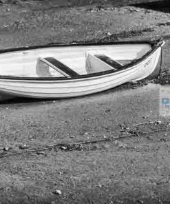 Black annd White photo of a dinghy at low tide on the River Teign near Shaldon