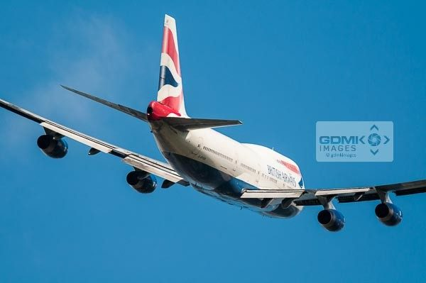 Rear view of a British Airways Boeing 747 Jumbojet aircraft banking away after taking off
