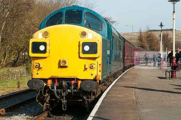 Class 37 loco in BR Blue colour scheme at the front of a passenger train on the East Lancs Railway