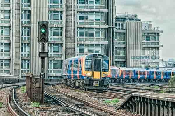 Digital art of a South Western trains commuter train approaching Vauxhall in South London