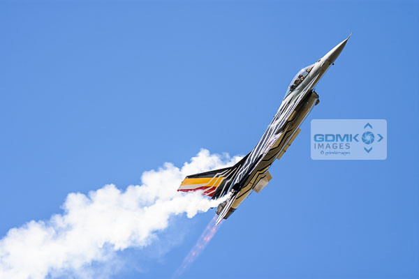 Royal Netherlands Airforce F-16 trailing white vapour during an airshow display