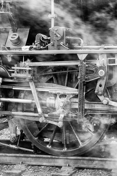 Close up view of a the mechanism around a steam locos wheel
