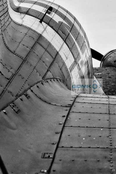 Rear view along the fuselage of a C-47 Dakota WW2 Troop Carrier aeroplane in Black and White
