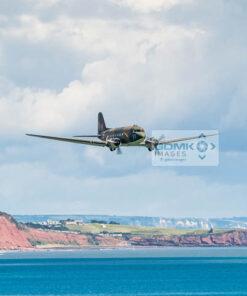 WW2 C-47 Dakota airplane flying low over the Devon Coast