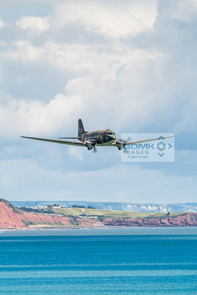 WW2 C-47 Dakota airplane flying low over the Devon Coast