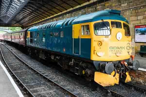 Class 26 diesel loco 26038 standing at the head of a passenger train at Pickering station on the North Yorks Moors Railway