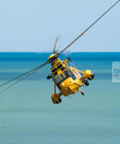 Royal Air Force Search & Rescue Seaking helicopter flying head on about to bank away