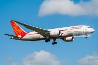 Side view of an Air India Boeing 787 Dreamliner aircraft on approach to land with landing gear down