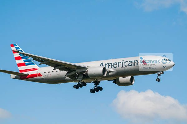 Side view of an American Airlines 777 aircraft on approach to land with landing gear down