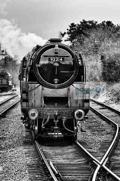 Front view of BR Standard 9F steam loco 92214 approaching Rothley station on the Great Central Railway
