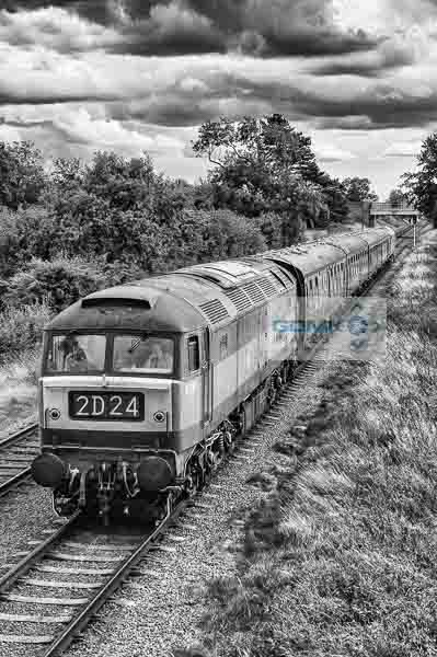 Black and white image of class 45 diesel locomotive D1705 recreating a scene from the 1970s and 80s as it heads a train on the Great Central Railway near Loughborough
