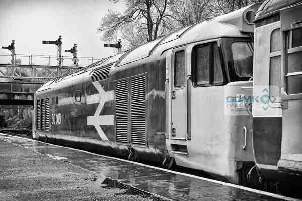 50015 Valiant standing in the rain at Bury Railway Station on the East Lancs Railway during the English Electric theme day on 11th January 2014. In the background is the impressive gantry of semaphore signals. The class 50 is heading a service to Heywood.