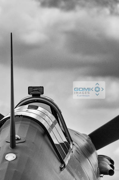 Black and white image of a Royal Air Force Hurricane under a stormysky