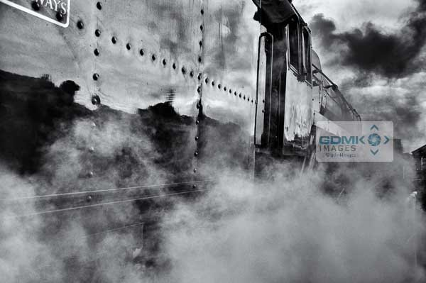 Atmospheric black and white picture of Class 9F steam loco engulfed in steam
