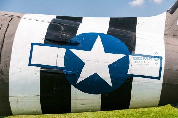 Black and white D Day invasion stripes on the fuselage of a C47 Dakota troop carrying aeroplane