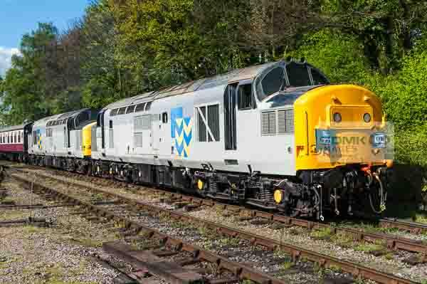 English Electric Class 37 locos 37227 and 37905 in Railfreight Metals livery double head a train at Shackerstone on the Battlefield Line
