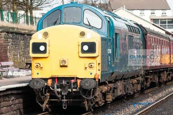 Class 37 loco in BR Blue colour scheme working a passenger train on the East Lancs Railway
