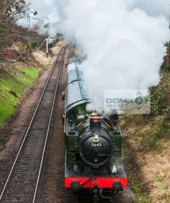 Looking down onto Great Western Railway 0-6-2T steam loco heading a passenger train on the Great Central Railway