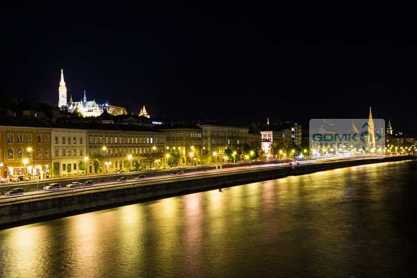 Matthias Church overlooking the reflections of the streets below in the River Danube in Budapest at night