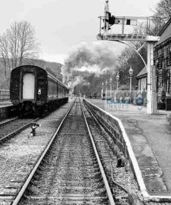 Black and white image of a steam train leaving Darley Dale railway station on the Peak Rail preserved railway