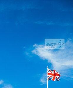 Union Jack flag against a blue sky