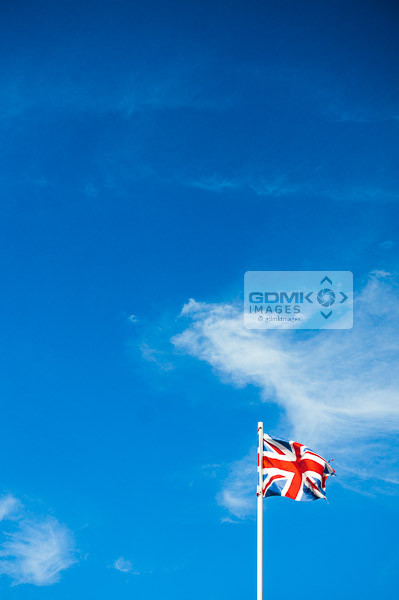 Union Jack flag against a blue sky
