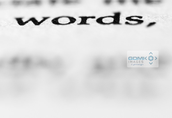 Closeup of text saying 'words' in a paperback book