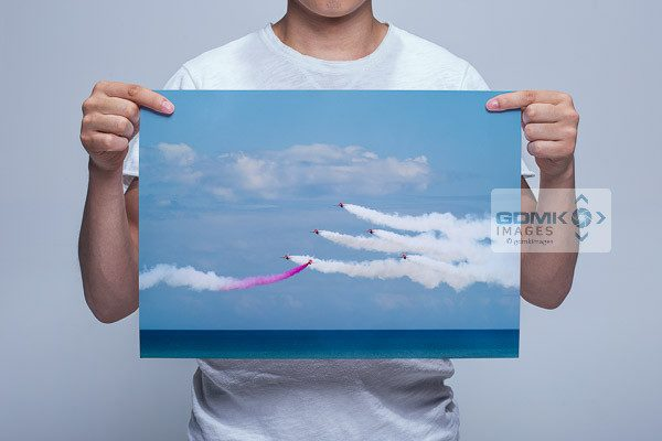 Man Holding Red Arrows Over the Sea Wall Art Print