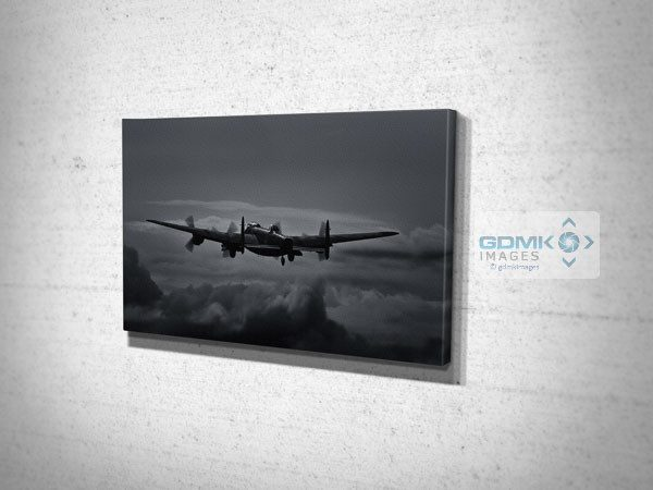 Canvas print featuring A Lancaster Bomber taking off into a moonlit sky
