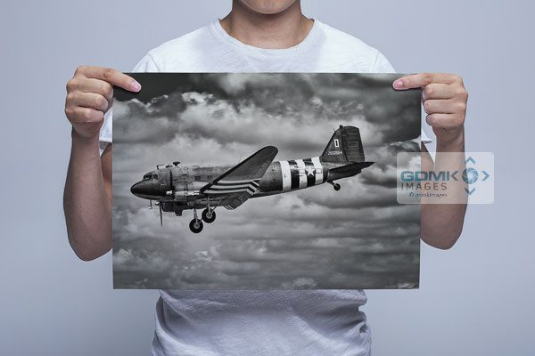 Man Holding Black and White C47 Wall Art Print