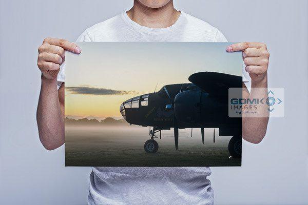 Man Holding Mitchell B-25 Bomber at Dawn Wall Art Print