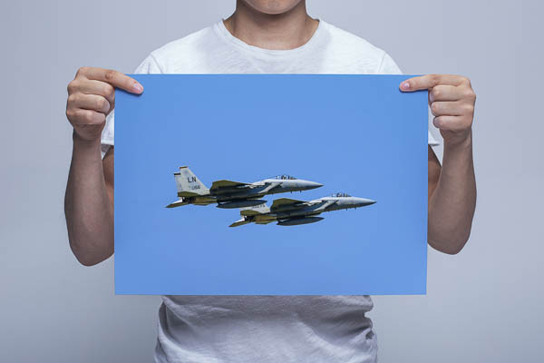 Man Holding Picture of an F-15 Pairs Takeoff Wall Art Print