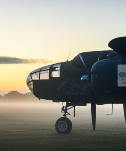 Mitchell B-25 Bomber 'Sarinah' of the Royal Netherlands Air Force Historical Flight basks in the early morning sunlight surrounded in mist at Headcorn Airfield