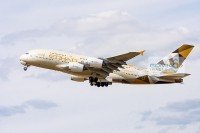 Side view of an Etihad Airways Airbus A380 aeroplane taking off from Heathrow Airport