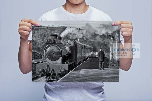Man Holding Black and White Steam Train at Darley Dale Station Wall Art Print