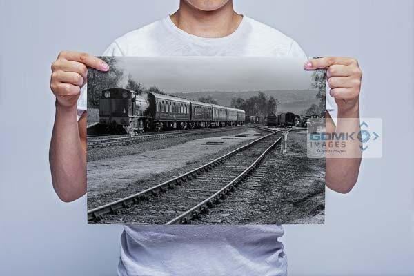 Man Holding Black and White Steam Train at Rowsley Station Wall Art Print