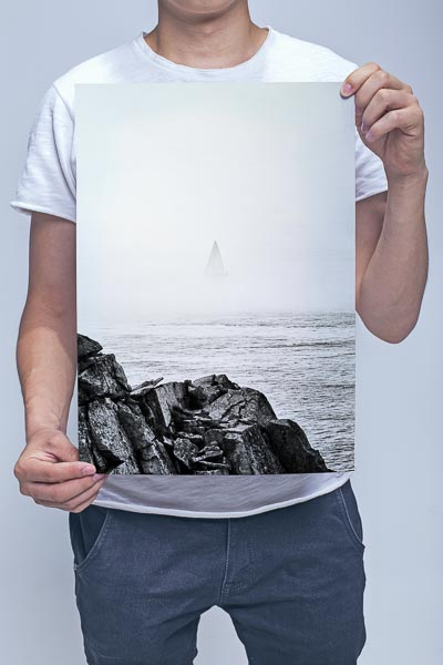 Man Holding Sailboat Disappearing Into the Sea Mist Wall Art Print