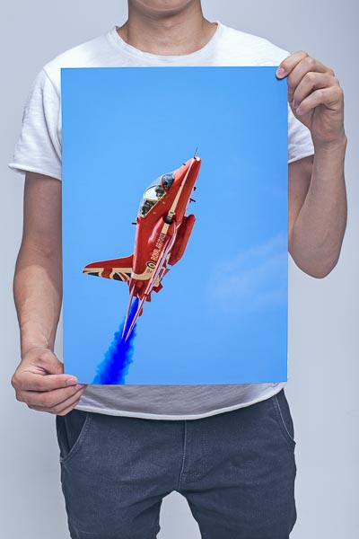 Man Holding Up Close to A Red Arrow Wall Art Print