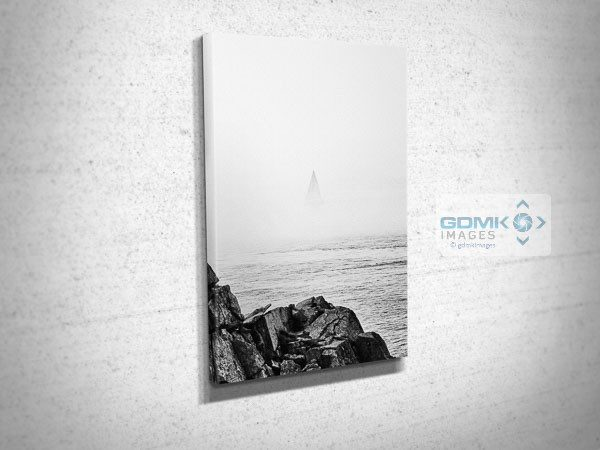 Sailboat Disappearing Into the Sea Mist Canvas Print