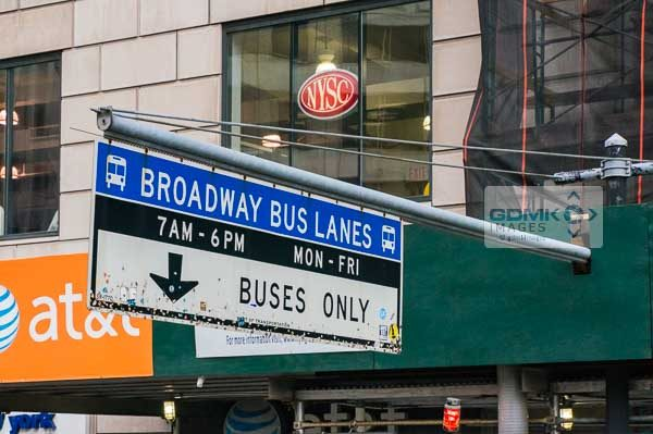Chewing gum on the bottom of a Broadway Bus Lanes traffic sign in New York