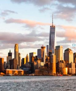 One World Trade Centre and the surrounding area bathed in evening sunlight seen from the Hudson River