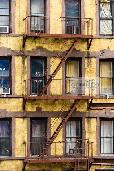 Fire escape stairs at the back of a run down apartment block as seen from ther High Line in New York