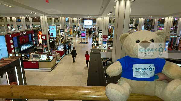 Ted patiently waits in Macys as we buy our New York Pass tickets