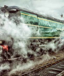 Bulleid Light Pacific 34081 92 Squadron engulfed in steam at Wansford railway station on the Nene Valley Railway