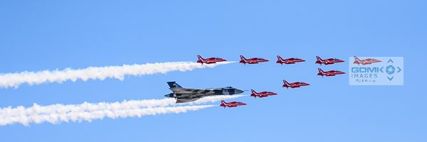 Avro Vulcan escorted by the Royal Air Force Red Arrows display team