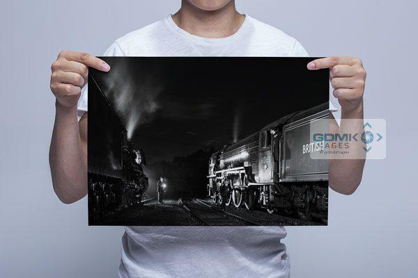 Man Holding Black and White 60103 Flying Scotsman and 60163 Tornado at Night Wall Art Print